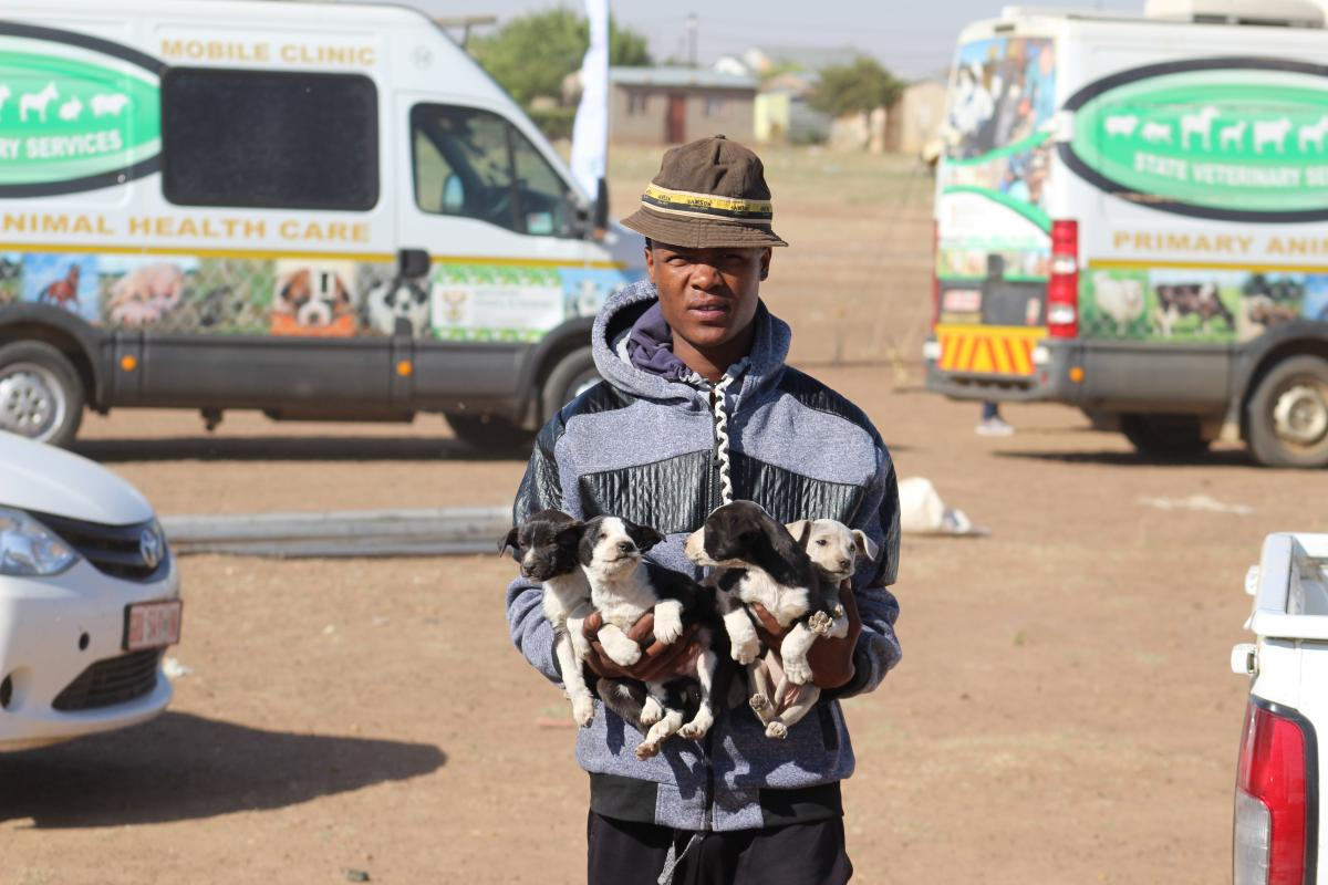 One of the community members from Ottosdall who had just vaccinated his puppies.