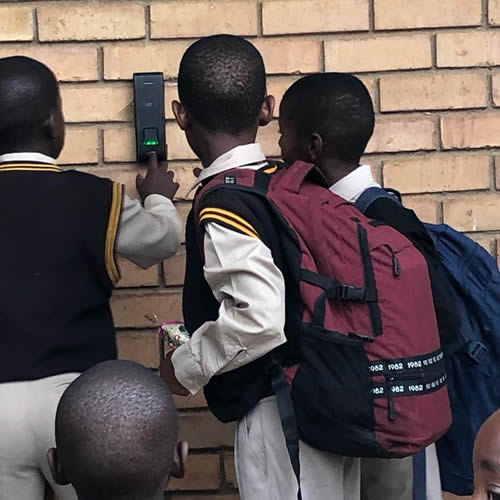 Pupils of the Ntji Mothapo Primary School in Polokwane, Limpopo, scan their fingerprints when they clock in at school.