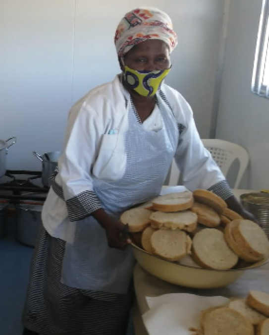 Members of the Phumalanga Nutrition and Development non-governmental organisation serve meals to the community of Tholeni village in Butterworth, Eastern Cape.