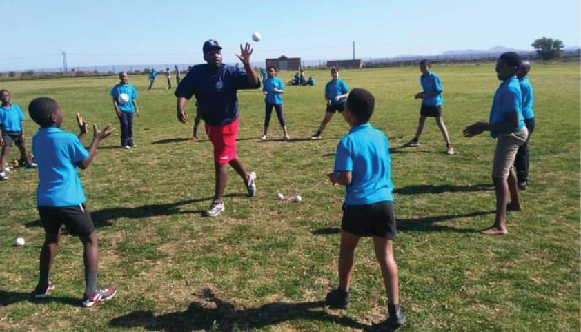 Baseball coach Lwazi Mlondolozi trains young players in the sport.