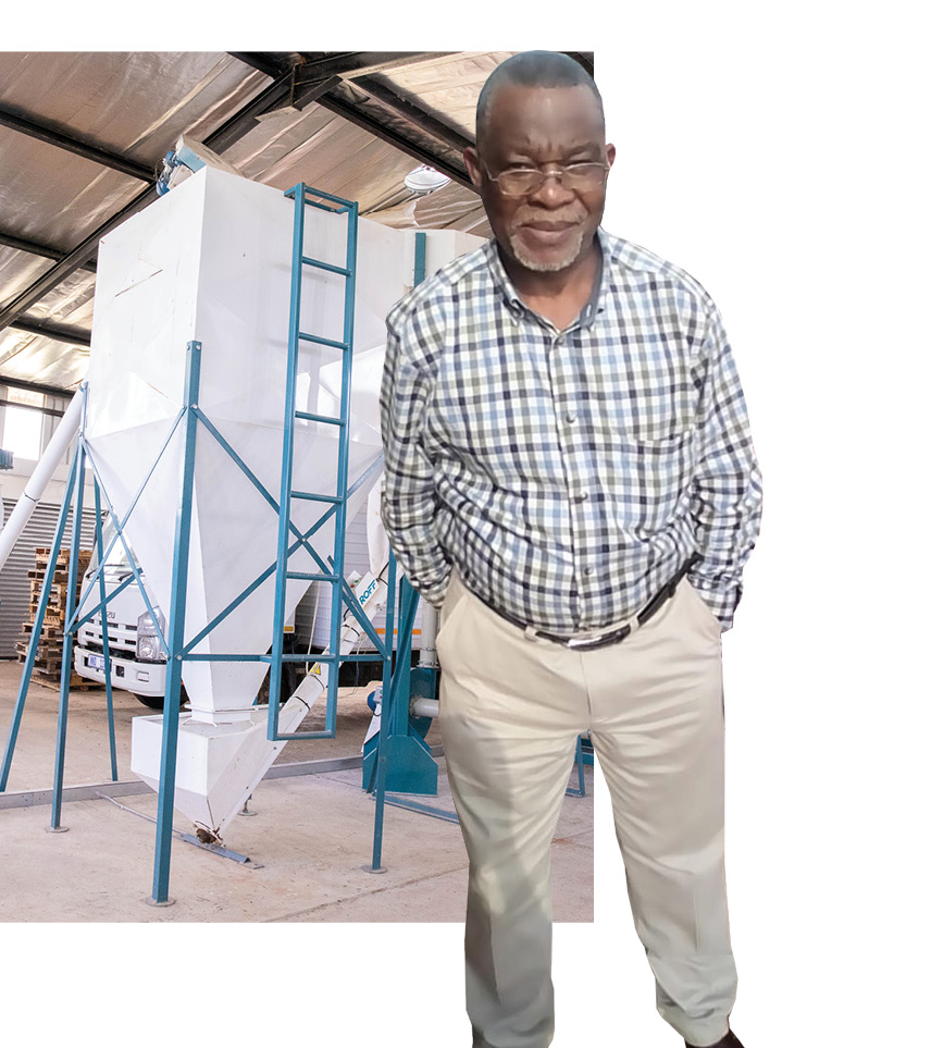 Treasurer of Maphophoma Milling Sipho Nyembe alongside the milling silos that were built by the ADA.