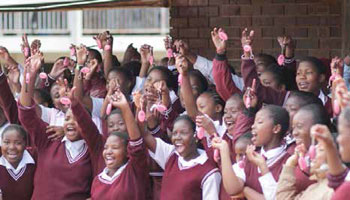 Delighted pupils showoff their Memeza personal alarms donated by the Memeza Women Empowerment Project.