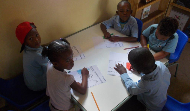 Learners at Paballo ECD learning to write.