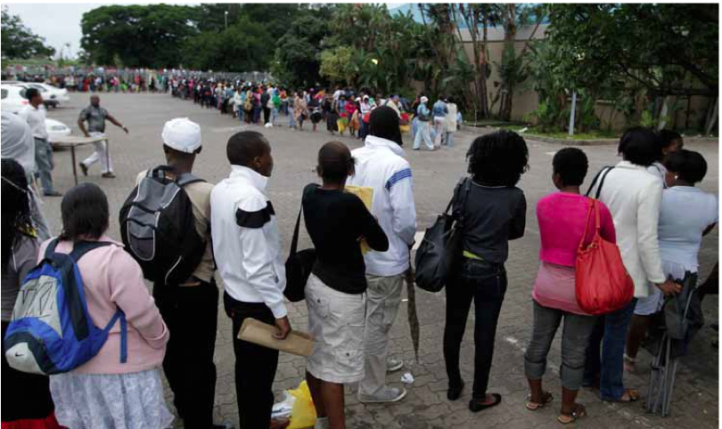 Photo caption: Students queue to apply for tertiary funding.