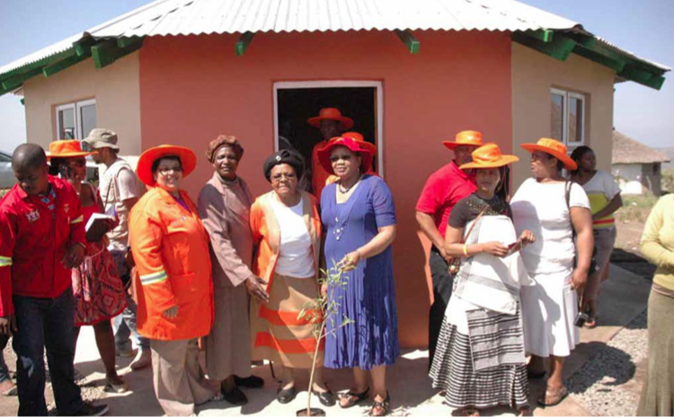 Photo caption: Eastern Cape MEC for Human Settlements, Safety and Liaison Helen Sauls-August hands over a new house in Kumanzi Village, Eastern Cape.