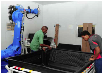 Photo caption: Employees of Babuthe Automotive Components work on bedliners for the new T6 Ranger, which are exported to Asia and Europe.