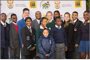 Sports and Recreation South Africa Director General Alec Moemi surrounded by the lucky young athletes who were awarded sports bursaries totalling R100 000 each