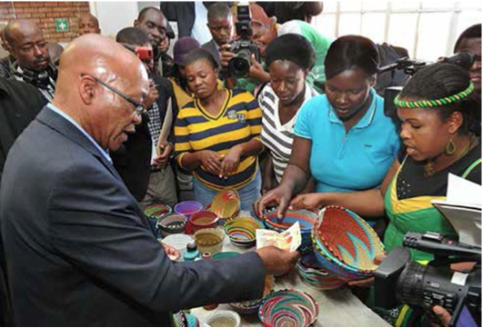 President Jacob Zuma went shopping in Muyexe, buying five large decorating bowls that Simango and her colleagues made out of straw.
