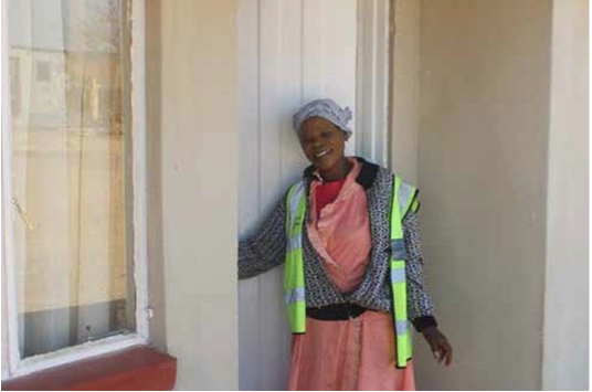 Kattie Sibiya, the proud owner of a new home built by the Mpumalanga Government in partnership with paper company Mondi