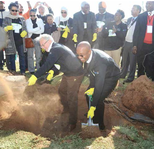 General Secretary of Metropolis Alain Le Saux and Joburg Mayor Parks Tau plant a tree in Sophiatown, with delegates looking on. (Photos: Enoch Lehung)
