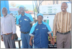 Site Manager Victor Maluleke, petrol attendants Sipho Gwatuli and Rosemary Thagwana and Secretary Ronald Rasimbi take pride in the work they do at the Mutale Integrated Energy Centre.