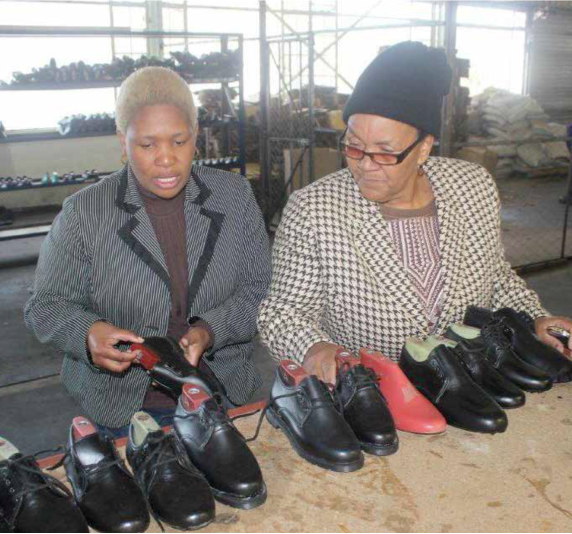 Nthako Moleboheng and Nomvula Finger with three other female members call themselves Halala Basadi Cooperative. They manufacture school shoes, morning slippers and sandals.