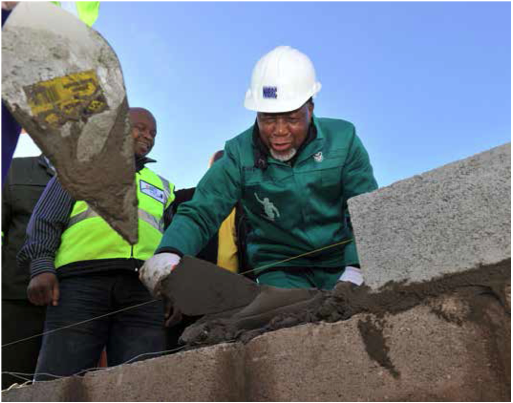 Deputy President Kgalema Motlanthe lends a helping hand during the War on Poverty building drive in Chatty in the Eastern Cape.