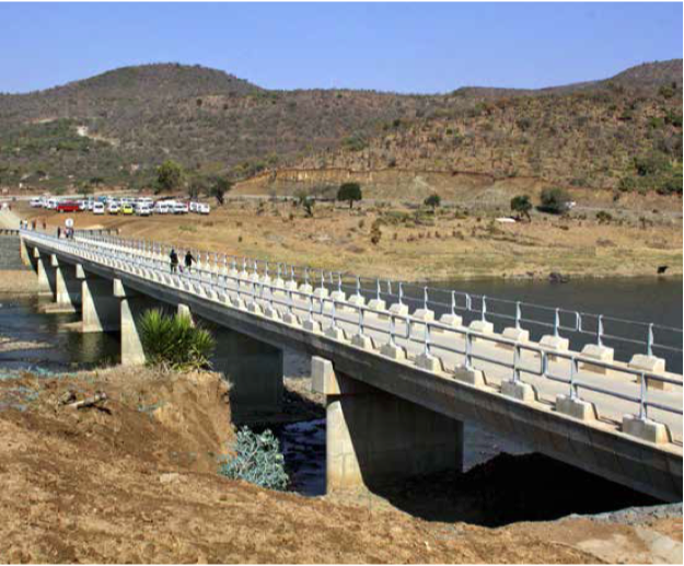 Positive changes: The new 135-metre Tugela River Bridge has stimulated economic activity, and improved access to education and health facilities between the villages of KwaNomoya and Sahlumbe in Ladysmith KwaZulu-Natal. (Inset) Safety first: Learners and community members are safe on the new bridge after years of risking crocodiles while crossing the river.