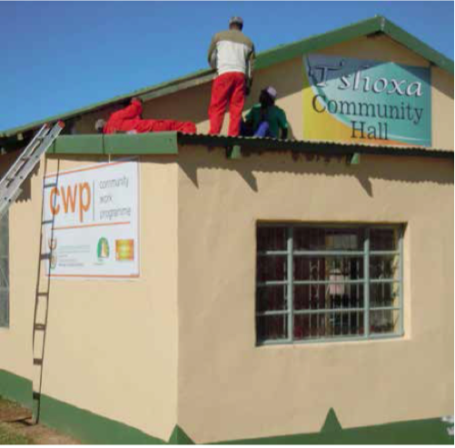 Community members install roofing during the upgrading of the hall in Keiskammahoek.