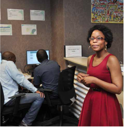 Transnet Enterprise Development Hub Manager Mathebe Tsomele at the reception area of the hub, while clients are on the CIPC website.