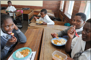 Government's National School Nutrition Programme offers hot meals to needy learners, ensuring they no longer attend school on an empty stomach.