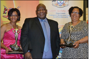 Lina Simboyia (left) and Tanya Anders scooped the top spots in the Northern Cape Women in Transport Awards, recently. Transport MEC Mac Jack presented Simboyia with the award in the Women Entrepreneurs in the Transport Industry category and Anders with the award in the Women with Best Outstanding Law Enforcement Role category.