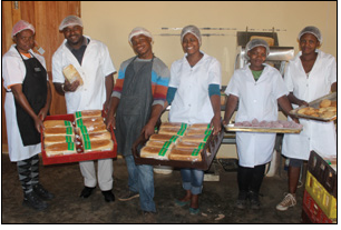 Thulasizwe Shabalala (second from left), one of the founders of the Thuthukamzizi Bakery Cooperative, and his workers have big dreams for their business, which has been put on the path to success thanks to the help of government agencies.