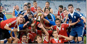Libya celebrates after edging out Ghana on penalties to lift the CHAN trophy.