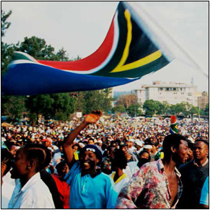 South Africans celebrate the inauguration of South Africa's first democratically elected President, the late Nelson Mandela in 1994.