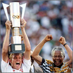 The late former President Nelson Mandela celebrates with the then captain Bafana Bafana Neil Tovey after South Africa won the 1996 African Cup of Nations.