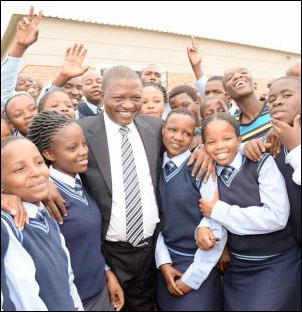 Learners at the new state-of-the-art boarding school in Mpumalanga share their joy over the new facilities with Premier David Mabuza.