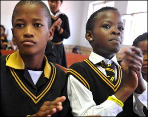 Grade 4 learners from the Gonyane Primary School in Mangaung celebrate during the launch of the HPV vaccination campaign at their school.