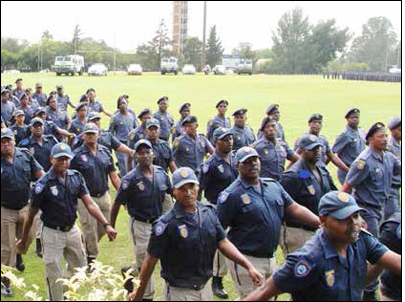 Metro Police officers and members of the SAPS Tactical Response Team participate in a passing-out parade after completing a course in crowd management.