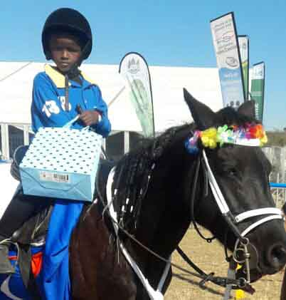 Anothe Buthelezi riding Blackberry after the Dundee July horse racing event.