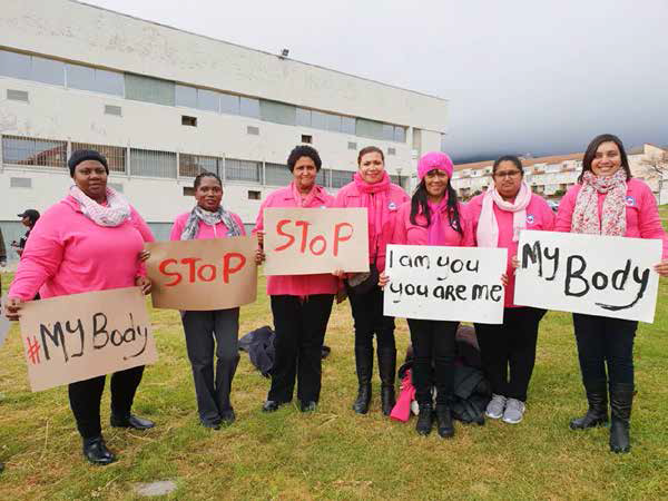 Staff from Sisters Incorporated who are part of the Womens Shelter Movement participate in a march against women abuse